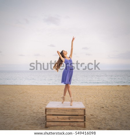 Ballerina posing on the beach