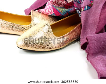 ballerina shoes and scarf on white background