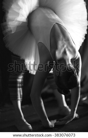 Ballerina stretching before going on stage