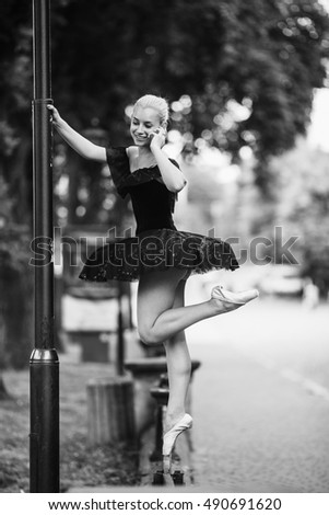 Ballerina talking on the phone on a city street