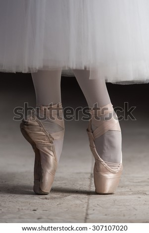 Ballerina walking tiptoe in  pointe shoes