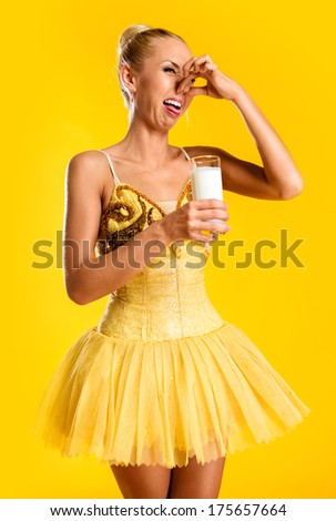 Ballerina with glass of milk  - stock photo
