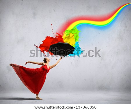 ballet dancer in flying satin dress with umbrella and a rainbow - stock photo