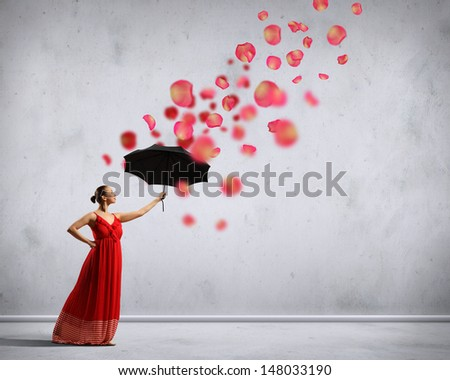ballet dancer in flying satin dress with umbrella under the paint - stock photo
