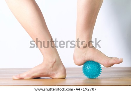ballet dancer massaging her foot