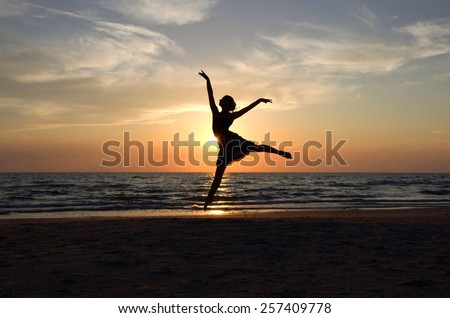 Ballet dancer's silhouette by the Sea in Sunset light