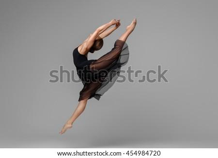 Ballet dancer woman black dress on gray background - stock photo