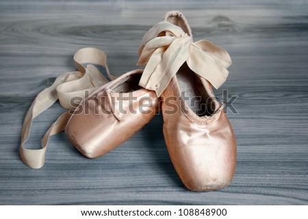 ballet slippers on a wood floor Bascjground - stock photo