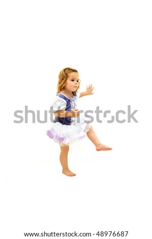 Ballet student daydreams as she goes through her ballet exercises.  She is wearing a tutu and purple with lace costume. - stock photo
