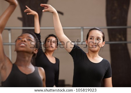 Ballet students rehearsing arm movements during practice
