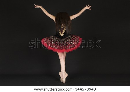 Ballet women in studio on black background. You can see her all photos in different figures in my portfolio. - stock photo
