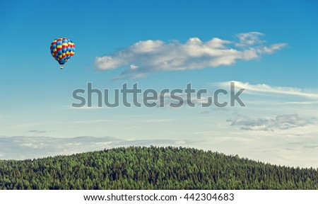 balloon flying over a beautiful landscape
