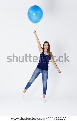 Balloon girl about to float away, portrait