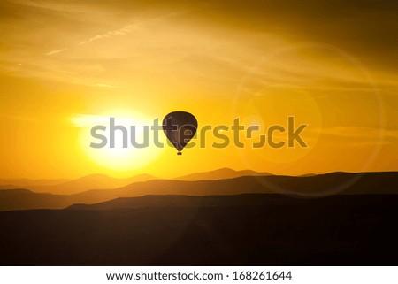 Balloon in Cappadocia at dawn sky background - stock photo
