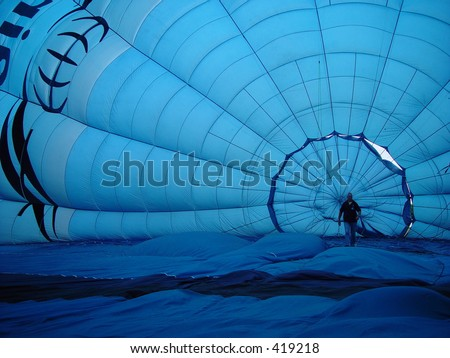 balloon, man walking inside a blue hot air balloon - stock photo