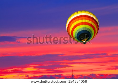 Balloon on Sunset / sunrise with clouds, light rays and other atmospheric effects - stock photo