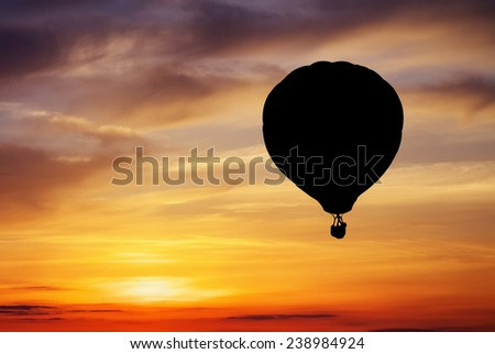 Balloon silhouette on sunset background.  - stock photo