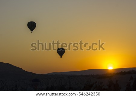 Balloon silhouette with sunrise in the sky. Cappadocia, Goreme,Turkey.