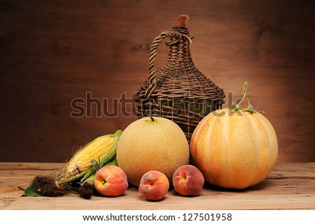 Balloon vine, peaches and melon on the table - stock photo