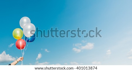 balloon with colorful on blue sky,vintage tone colour.
