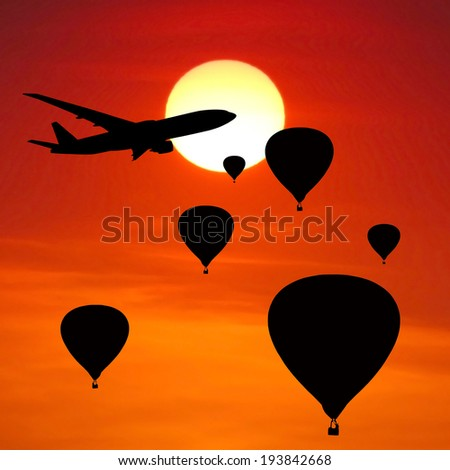 balloons and airplane silhouette on sunset background. - stock photo