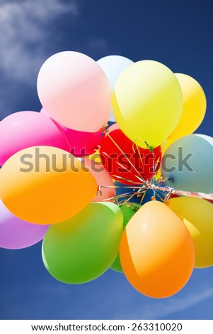balloons and celebration concept - lots of colorful balloons in the sky