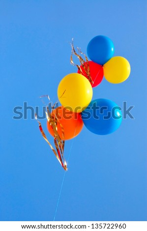 balloons in blue bright sky