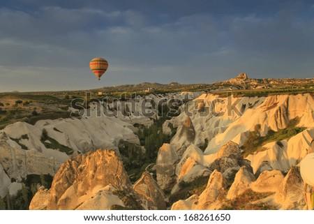 Balloons in Cappadocia over the hills - stock photo