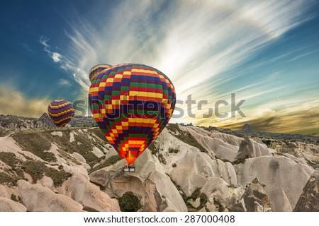 balloons in mountain, Cappadocia, Turkey - stock photo