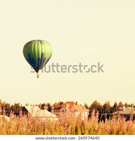 Balloons in the sky at sunrise.Vintage retro style - stock photo