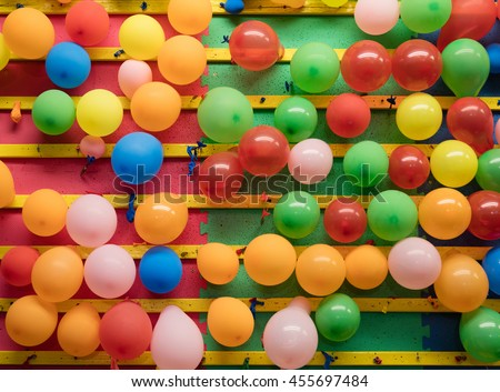 Balloons on a wall of an amusement park game - stock photo