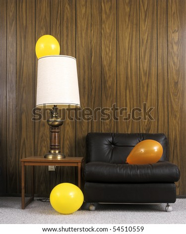 Balloons on furniture after a party - stock photo
