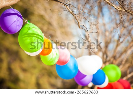 Balloons on the party in the park on the sunny day. - stock photo
