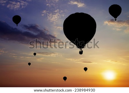 Balloons silhouettes on sunset background.  - stock photo
