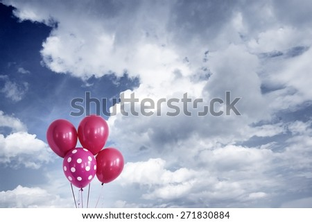balloons with cloudy sky - stock photo