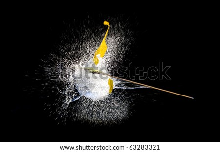 Balloons with water bursting punctured by arrow.High speed photography. - stock photo