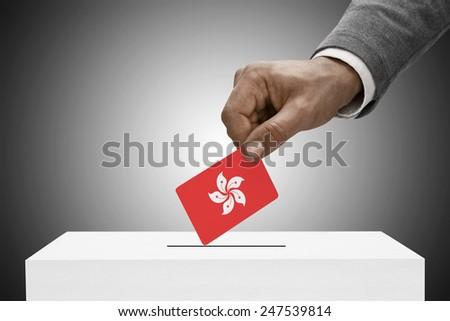 Ballot box painted into national flag colors - Hong Kong - stock photo