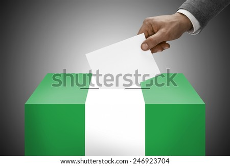 Ballot box painted into national flag colors - Nigeria - stock photo