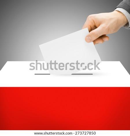 Ballot box painted into national flag colors - Poland - stock photo