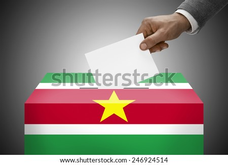 Ballot box painted into national flag colors - Republic of Suriname - stock photo
