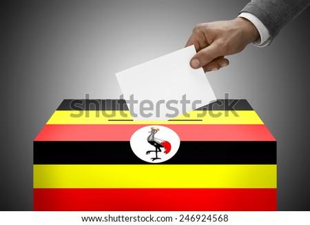 Ballot box painted into national flag colors - Uganda - stock photo
