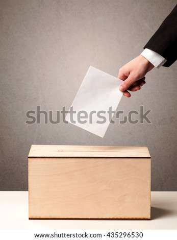 Ballot box with person casting vote on blank voting slip, grungy background - stock photo