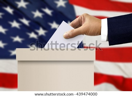 Ballot box with person hand casting a vote  - stock photo