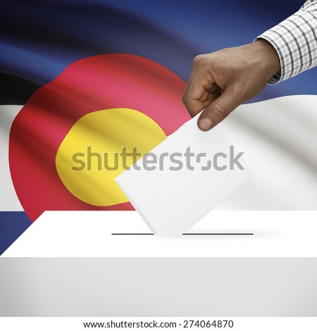 Ballot box with US state flag on background - Colorado - stock photo