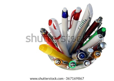 Ballpoint pens set of different types and colors in the glass