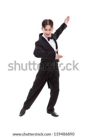 ballroom dancer dressed in a tailcoat posing against isolated white background - stock photo