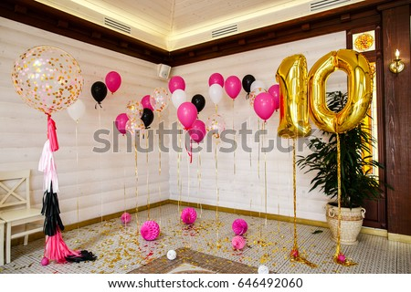 Balls And Balloons In Room Decorated For Birthday Party.