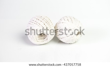 Balls of baumwolle yarn cotton wool. Isolated on empty background. Slightly de-focused and close-up shot. Copy space.