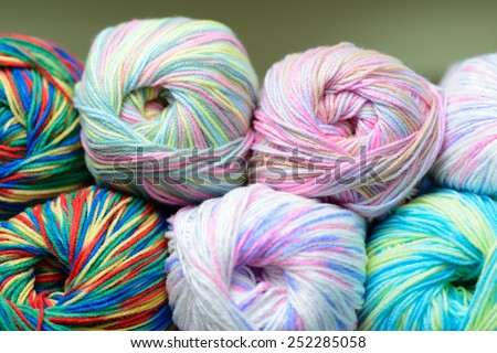 Balls of Bright colored yarn stored on shelf - stock photo