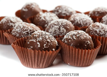 balls of chocolate covered coconut on white background